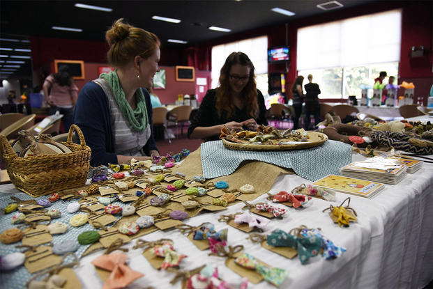 An Air Force spouse displays crafts at a home business expo. (Photo: U.S. Air Force/ Senior Airman Michael)