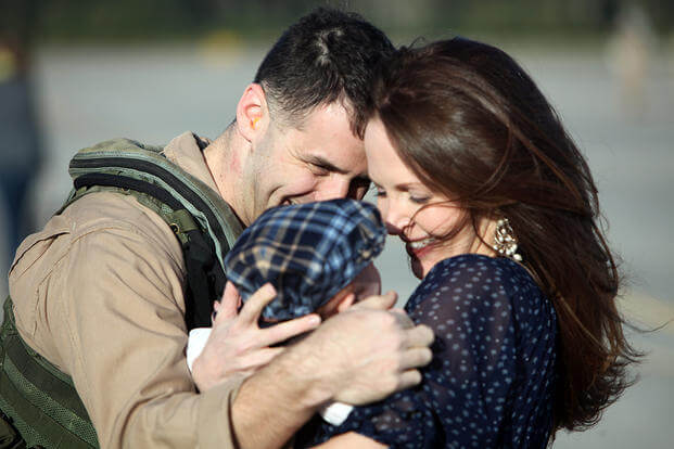 A Marine with Fighter Attack Squadron 251 is reunited with his family. (Photo: U.S. Marine Corps/Lance Cpl. Timothy Norris.)