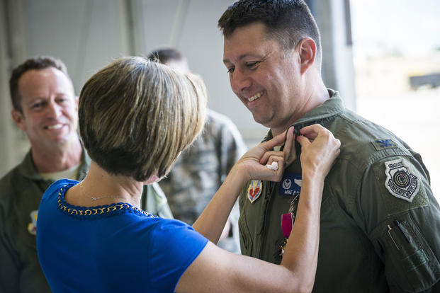 Veronica Ballek, wife of Col. Michael Ballek, pins a retirement pin on her husband during his retirement ceremony at Mountain Home Air Force Base, Idaho, June 2, 2015. Tech. Sgt. Samuel Morse/Air Force