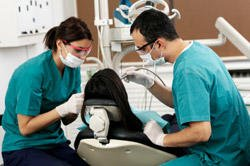 healthcare dental hygienist with patient