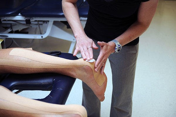 Angelique Ruiz, a physical therapist at the Officer Candidates School branch clinic, performs a therapeutic treatment. (U.S. Marine Corps/Lance Cpl. Tabitha Bartley)