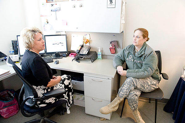 Cynthia Basham, a registered nurse case manager with the Fort Hood Warrior Transition Brigade, speaks with Staff Sgt. Christine Einig-Blackwell, a WTB squad leader. (U.S. Army photo)