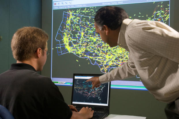 Discussing the traffic situation in the continental U.S. with the help of Future Air Traffic Management (ATM) Concepts Evaluation Tool (FACET). (Photo: NASA Ames / Dominic Hart)