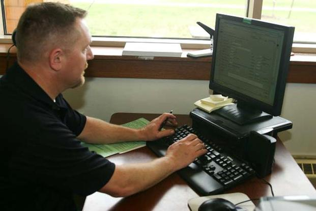 Soldier works on a computer. (Photo: Army.mil)