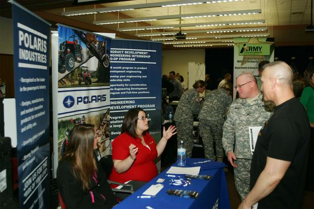 FILE -- Soldiers talk with employers during the Hiring Our Heroes job fair at Fort McCoy, Wis. Hundreds of service members, veterans and prospective employers attended the event. (Army Photo/Scott T. Sturkol)