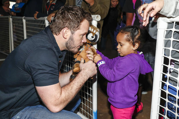 SAN DIEGO, CA - DECEMBER 12: Actor Chris Pratt signes autographs for fans at Marine Corps Air Station Miramar on December 12, 2016 in San Diego, California.
