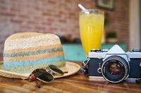 tropical drink, beach hat, camera, vacation