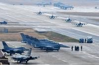 U.S. Air Force F-16 Fighting Falcon fighter aircraft, assigned to the 36th Fighter Squadron, participate in an elephant walk during Exercise VIGILANT ACE 18 at Osan Air Base, Republic of Korea, Dec. 3, 2017. (U.S. Air Force photo/Franklin R. Ramos)