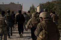 U.S. Marine advisors with Task Force Southwest and advisors with Resolute Support walk through the Regional Training Center compound to begin their assessment and evaluations in Lashkar Gah, Afghanistan, Nov. 15, 2017. (U.S. Marine Corps photo)