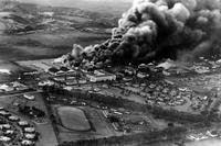 Planes and hangars burning at Wheeler Army Base during the Japanese attack on Pearl Harbor, Hawaii, Dec. 7, 1941. (U.S. Navy)