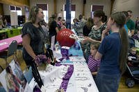 Spouses shop during a Spouse Appreciation Day Bazaar at the Thomas Community Activities Center at Little Rock Air Force Base, Arkansas. (U.S. Air Force/Cliffton Dolezal)