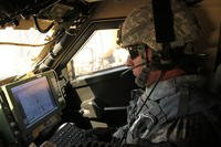 A 2nd Brigade, 1st Armored Division soldier demonstrates Warfighter Information Network-Tactical Increment 2 and Mission Command on the move applications during the Network Integration Evaluation 12.1, Nov. 18, 2011. (U.S. Army photo/Katie Cain)
