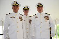 From left, Capt. Andrew Tucci, commander of Sector Long Island Sound, stands with Rear Adm. Steven Poulin, commander of Coast Guard First District, and retired Capt. Edward Cubanski during a change-of-command ceremony at the sector in New Haven, Connecticut, on July 8, 2016. Steve Strohmaier/Coast Guard