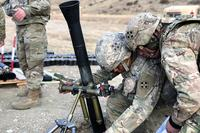 Pfc. Bryce Marcille, left, with Headquarters and Headquarters Company, 2nd Battalion, 12th Infantry Regiment, 2nd Infantry Brigade Combat Team, sets the elevation on an 81mm mortar system as Spc. Brian Torres, right, monitors through the sight piece during range training at Fort Carson, Colo., on Jan. 25, 2018. Several 2-12 Infantry soldiers conducted range qualification training in preparation for the War Horse Brigade's upcoming deployment to Afghanistan. (Photo by Spc. Connor Owens/Army)