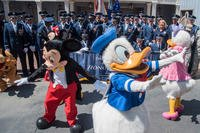 Disney characters run in front of a U.S. Air Force Honor Guard group photo at Disneyland in Anaheim, Calif., June 29, 2017. (U.S. Air Force/Jordyn Fetter)