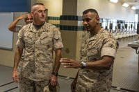 Lt. Col. Joshua Kissoon (right), commanding officer of 3rd Recruit Training Battalion, gives a tour of the 3rd Battalion barracks to Maj. Gen. James Lukeman, the commanding general of Marine Corps Training and Education Command, Oct. 9, 2014, on Parris Island, S.C. (U.S. Marine Corps/David Bessey)