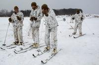 Marines with Charlie Company, Battalion Landing Team, 1st Battalion, 1st Marines, 31st Marine Expeditionary Unit, take a short break during ski and sled drills as part of company unit-level training at Camp Sendai, Miyagi, Japan, Feb. 21, 2018. (Stormy Mendez/Marine Corps)