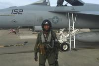 Courtland Savage posing with an F/A-18 while training at VFA-106. (Courtesy Courtland Savage)