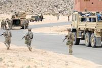 Dismounted Soldiers of Company B, 1st Battalion, 155th Infantry Regiment, Mississippi Army Guard provide security for a civilian evacuation exercise at the National Training Center, Fort Irwin, California on May 31, 2017. (Mississippi National Guard/Sgt. Edward Lee, 102d Public Affairs Detachment)