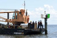 Crew members from Coast Guard Cutter Vise, a construction tender based in St. Petersburg, Fla., repair a navigation aid near Tampa Bay, Sept. 12, 2017. Coast Guard Crews from the Tampa area evaluated the condition of the port and rebuilt damaged navigation markers in order to reopen the port to traffic. (Coast Guard photo/Steve Strohmaier)