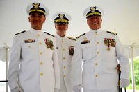 From left, Capt. Andrew Tucci, commander Sector Long Island Sound, stands with Rear Adm. Steven Poulin, commander of Coast Guard First District, and retired Capt. Edward Cubanski during a change-of-command ceremony at the sector in New Haven, Connecticut, on July 8, 2016. (US Coast Guard photo/Steve Strohmaier)