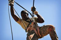 Sgt. Christian Henry with 75th Ranger Regiment fast ropes down the Prusik climb tower during Best Ranger 2011. (US Army/Alexandra Hemmerly-Brown)