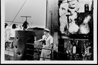 Navy Commander William L. McGonagle, skipper of the USS Liberty (AGTR-5), points out damage inflicted on the ship's superstructure when Israeli forces attacked the intelligence-gathering ship off the Sinai Peninsula on June 8, 1967. The photograph was taken on June 16, two days after Liberty arrived at Valletta, Malta, for repairs. (US Navy photo via Naval History and Heritage Command)