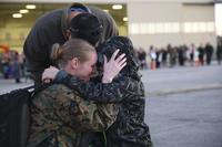 A Marine embraces her son and husband aboard Marine Corps Air Station Beaufort Jan. 12. (U.S Marine Corps/Lance Cpl. Kayla Rainbolt)