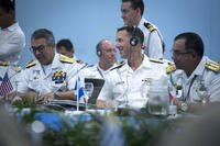 July 25: Chief of Naval Operations Adm. John Richardson (with headphones) participates in the 28th Inter-American Naval Conference in Cartagena, Colombia. (US Navy photo/Elliott Fabrizio)