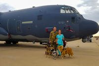 U.S. Air Force Capt. Daniel Hale, 563rd Rescue Group officer in charge of plans and scheduling, and his wife Dr. Kristen Hale, veterinarian, pose in front of an HC-130J Combat King II with their rescue pets at Davis-Monthan Air Force Base, Arizona. (Courtesy of Kristen Hale)