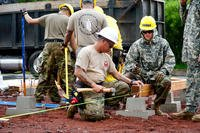 Hawaii Army National Guardsmen build 20 micro-shelters in Pahoa, Hawaii, in June. In some cases, Guardsmen have waited more than a month to get their first paycheck. (US Air National Guard photo/James Ro)