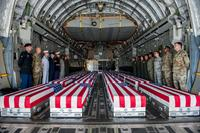 Transfer cases, containing the remains of what are believed to be U.S. service members lost in the Korean War, line the bay of a U.S. Air Force C-17 Globemaster III aircraft during an honorable carry ceremony at Joint Base Pearl Harbor-Hickam, Hawaii, Aug. 1, 2018.. (U.S. Air Force/Senior Airman Apryl Hall)