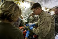 U.S. Navy medical personnel treat a simulated casualty during a mass casualty exercise at an undisclosed location in Southwest Asia, Dec. 23, 2015. (U.S. Marine Corps/Sgt. Rick Hurtado)