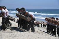 First Phase Basic Underwater Demolition/SEALs candidates participate in log physical training at Naval Amphibious Base Coronado, July 14, 2016. (U.S. Navy photo by Mass Communication Specialist 2nd Class Timothy M. Black)