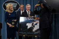 Then-Secretary of the Navy Ray Mabus and ship's sponsor, Jill Biden, watch as Vice President Joe Biden puts on a USS Delaware ball cap at the Pentagon announcing the name the future Virginia-class attack submarine USS Delaware (SSN 791) in Nov. 2012. (U.S. Navy photo/Sam Shavers)