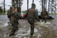 Marines help push a car out of a flooded area at Camp Lejeune, North Carolina, on Sept. 15, 2018, during Hurricane Florence. H(U.S. Marine Corps photo by Lance Cpl. Isaiah Gomez)
