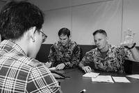 Rear Adm. Joey Tynch, commander, Task Force 73, explains the importance of maritime domain awareness during a media interview for Southeast Asia Cooperation and Training (SEACAT). (Dept. of Defense photo)