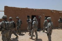 U.S. soldiers assigned to 1st Platoon, 1/37th Armored Delta Company, 1st Brigade, 1st Armored Division conduct a reconnaissance mission in the village of Fukara, Iraq, July 7, 2010. (U.S. Army photo/Charles Smith)