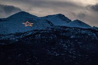 Since 1958, the Christmas star has illuminated the skyline of Anchorage. The star sits atop Mount Gordon Lyon in the Chugach mountain range at Joint Base Elmendorf-Richardson and is lit every year in conjunction with Anchorage's City of Lights celebration. (U.S. Air Force photo/James Richardson)