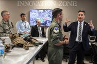 Rep. Mark Takano of California's 41st congressional district, right, talks to 163d Attack Wing Vice Commander Col. Keith Ward, second from right, while touring the wing's new Hap Arnold Center Feb. 23, 2017 at March Air Reserve Base, California. (Air National Guard photo/Crystal Housman)