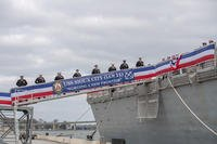 "Sailors man the rails after ""bringing the ship to life"" during the commissioning of USS Sioux City (LCS 11), Nov. 17, 2018. Sioux City is the 13th littoral combat ship to enter the fleet and the sixth of the Freedom variant. It is the first ship named for Sioux City, the fourth-largest city in Iowa. (U.S. Navy photo/Stacy Godfrey)"