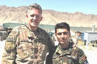 Brent Taylor, left, has been identified as the service member killed in an apparent insider attack in Afghanistan on Nov 3. Last week, Taylor wrote that the man standing next to him, Lt. Kefayatullah, was killed in a Taliban attack. (Facebook photo)