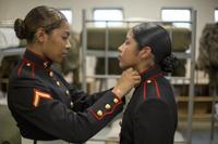 Pfc. Kathy Espinoza, from New York City, N.Y. inspects the new dress uniform of Pvt. Arella Aleman, from Dallas, Texas Nov. 9, 2018 at Marine Corps Recruit Depot Parris Island, S.C. (U.S. Marine Corps/Staff Sgt. Tyler Hlavac)