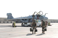 Marines deployed with Marine Tactical Electronic Warfare Squadron 2 walk to their EA-6B Prowler at Al Udeid Air Base, Qatar on Sept. 12. VMAQ-2 has completed its final deployment, and the last six Prowlers in the U.S. military's inventory are being retired. (US Air Force photo/Ted Nichols)