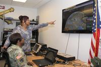 Capt. Tawanda Baxter and Flora Marshall, of Army Project Manager Mission Command, demonstrate the Tactical Interface Tracking Application Node at Aberdeen Proving Ground, Maryland, on Dec. 4, 2018. (U.S. Army/Dan Lafontaine)