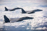 F-15C Eagles fly in formation over the East China Sea Dec. 11, 2018, during a routine training exercise out of Kadena Air Base, Japan. (U.S. Air Force photo/Matthew Seefeldt)