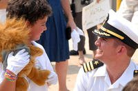 Then-Cmdr. Thomas R. Buchanan, commanding officer of the Los Angeles-class attack submarine USS Albany, greets his son on the pier after returning to Naval Station Norfolk after a six-month deployment, Aug. 2010. (U.S. Navy photo/Danna Morris)