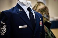 Uniforms from different eras are displayed with master sergeant Stripes during the 2017 Senior NCO induction ceremony at Barksdale Air Force Base, La., Aug. 18, 2017. (U.S. Air Force photo/Mozer O. Da Cunha)