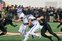 An Army Black Knights football player tackles an Air Force Falcons player at Michie Stadium in West Point, N.Y., Nov. 3, 2018. (U.S. Army photo by Brandon OConnor)