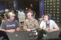 "Capt. Ryan Lewis talks to Sgt. 1st Class Christopher Jones and @twitch.tv shout caster James ""jchensor"" Chen during the Army Entertainment Esports Street Fighter V tournament 11 August 2018, at the Alternate Escapes Café at Fort Gordon, Georgia. (U.S. Army 2nd Recruiting Brigade)"